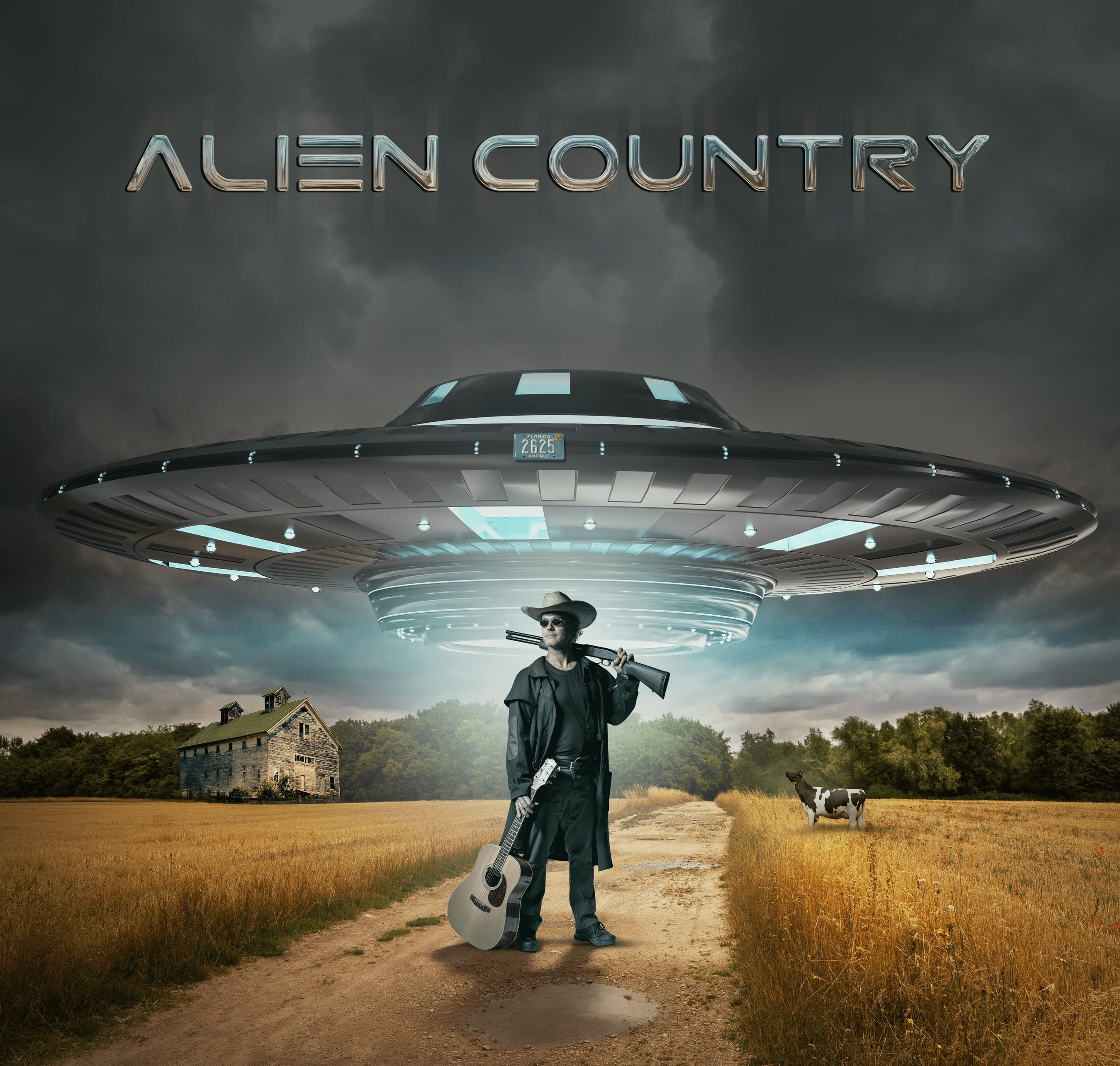 a photo of Liam standing on a dirt road wearing a cowboy hat, sunglasses a long black coat with a shotgun slung over one shoulder and a guitar by his side. A large UFO is hovering over his head as if it is about to beam him up. country rock